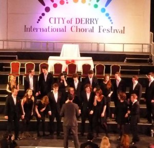 Voci Nuove conducted by Colm O'Regan compose themselves to sing after winning the international competition