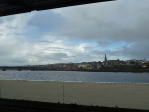 Craigavon Bridge, St Columb's Cathedral and the old city of Derry looking across the Foyle from Waterside station